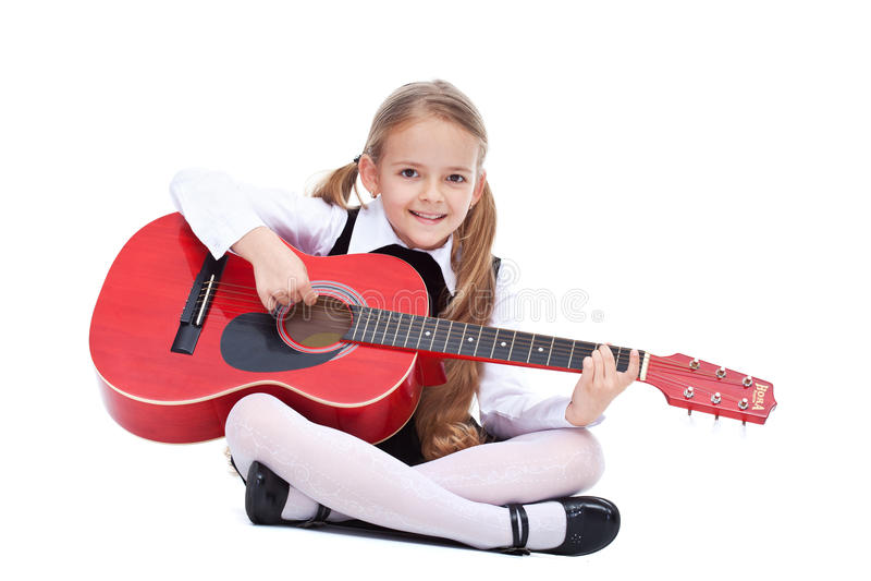 Gelukkig meisje met gitaar stock foto