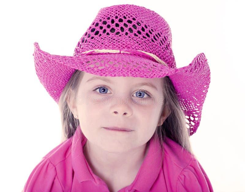Gelukkig meisje met roze cowboyhoed stock foto's