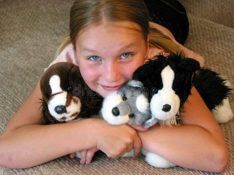 Gelukkig meisje met speelgoed royalty-vrije stock fotografie