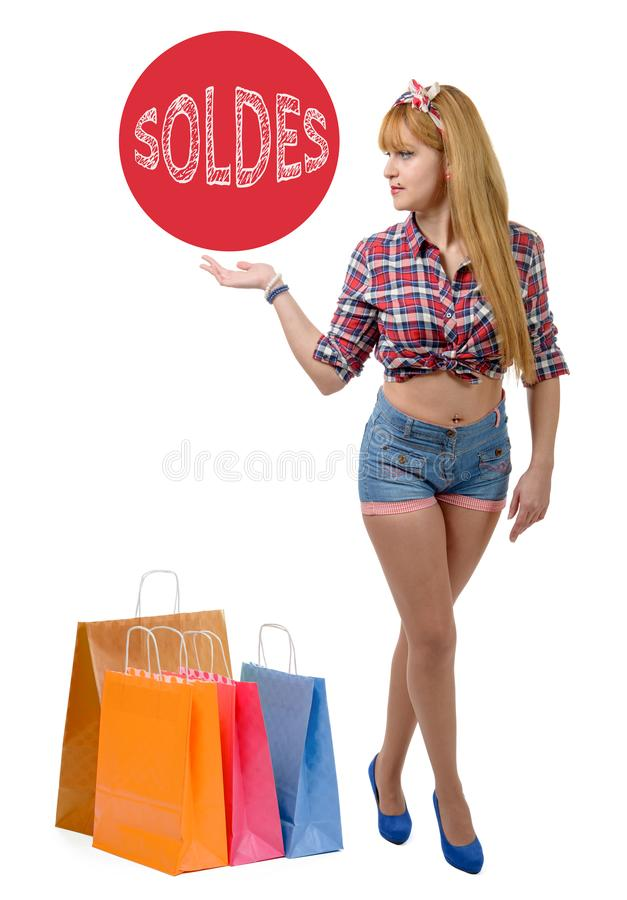 Gelukkig meisje shopaholic met gekleurde het winkelen zakken stock foto's