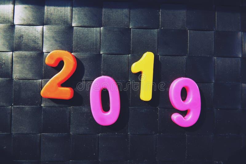 Gelukkig nieuw jaar 2019, Magnetische Alfabetletters & Getallen - Plastic Onderwijsstuk speelgoed royalty-vrije stock fotografie