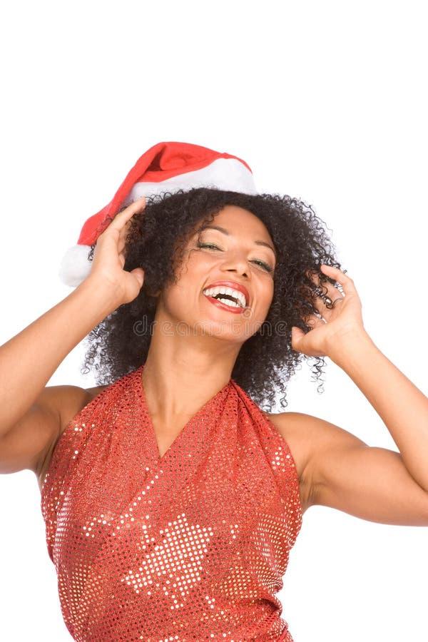 Gelukkig opgewekt etnische Mevr. Claus in de hoed van Kerstmis royalty-vrije stock foto's