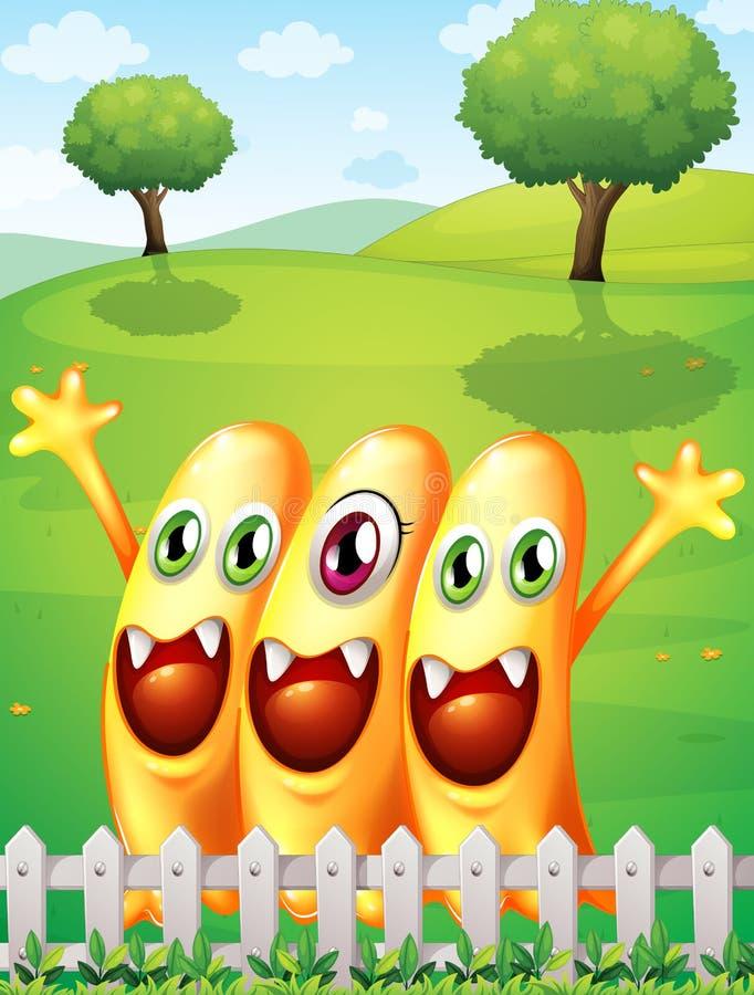 Gelukkig oranje monster drie dichtbij de omheining stock illustratie