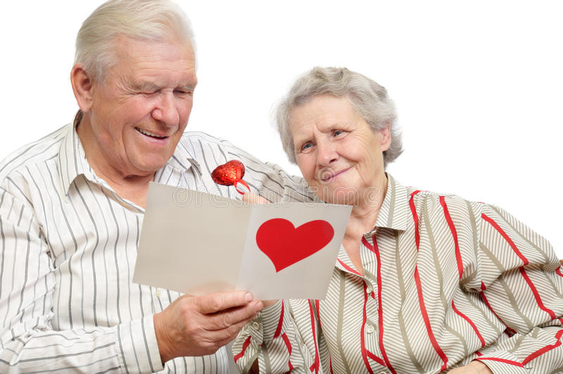 Gelukkig oud paar met prentbriefkaar stock foto's