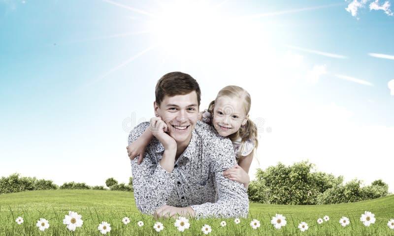 Gelukkig ouderschap stock foto's