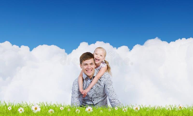 Gelukkig ouderschap stock afbeelding