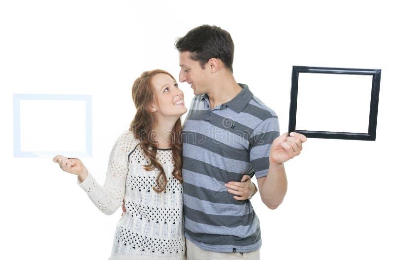 Gelukkig paar in kader Mooi Jong Paar royalty-vrije stock afbeelding