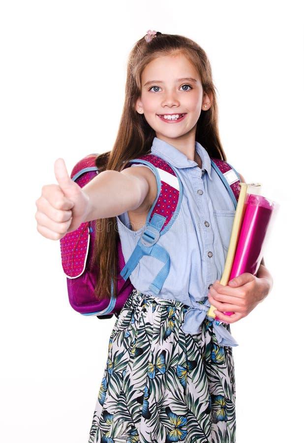 Gelukkig portret van het leuke glimlachen weinig het kindtiener van het schoolmeisje met vinger omhoog en rugzak die de boeken ge stock fotografie