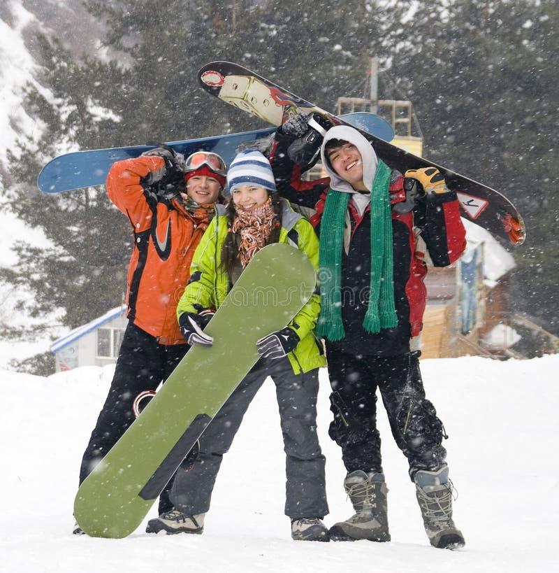 Gelukkig snowboarding team, gezondheidslevensstijl royalty-vrije stock afbeelding