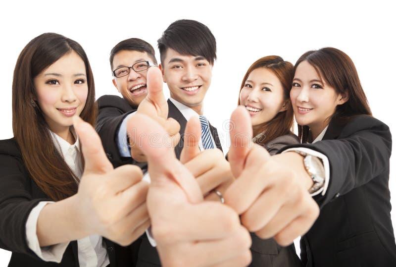 Gelukkig succesvol commercieel team met omhoog duimen stock fotografie