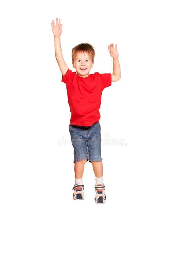 Gelukkig weinig jongen het springen. Geïsoleerd op wit royalty-vrije stock afbeelding