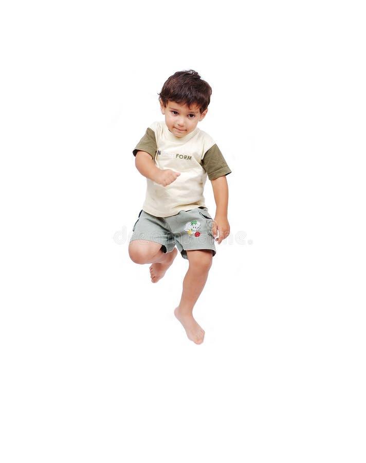 Gelukkig weinig kind in witte kleren stock foto