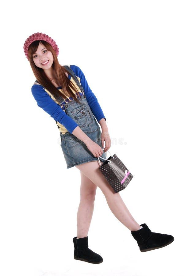 Gelukkig winkelend meisje. stock afbeelding