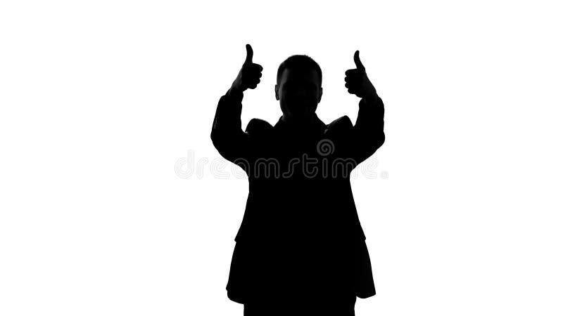 Gelukkig zakenmansilhouet die duimen tonen, succes, grote voltooiing stock foto