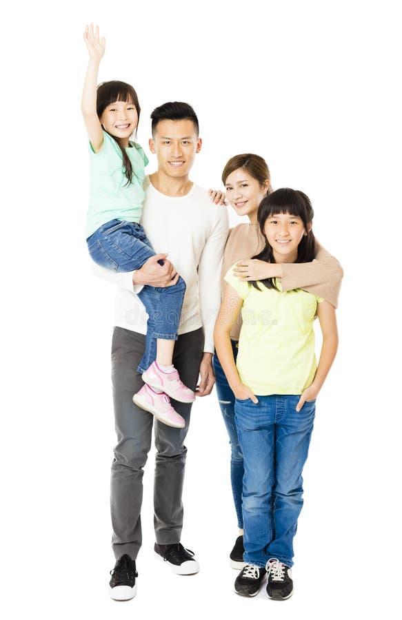 Gelukkige Aantrekkelijke Jonge Familie die zich verenigen royalty-vrije stock afbeelding