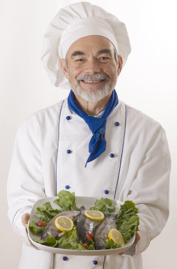 Gelukkige aantrekkelijke kok royalty-vrije stock afbeeldingen
