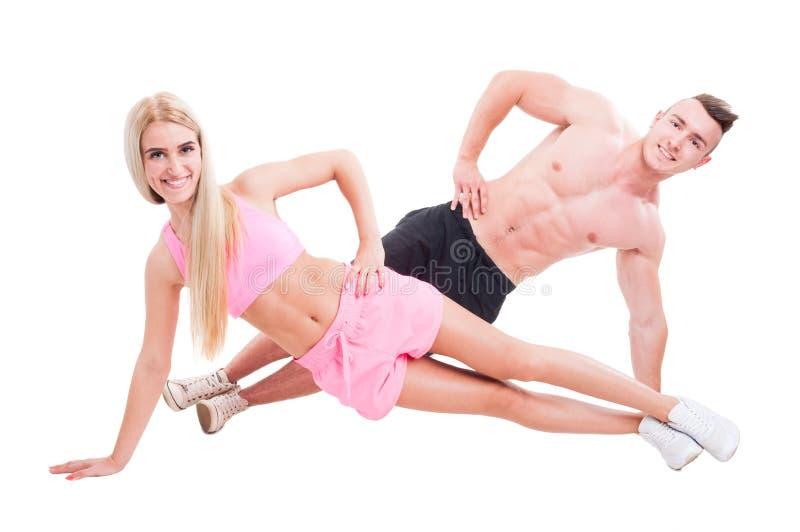 Gelukkige actieve en sportieve paaroefening samen stock fotografie