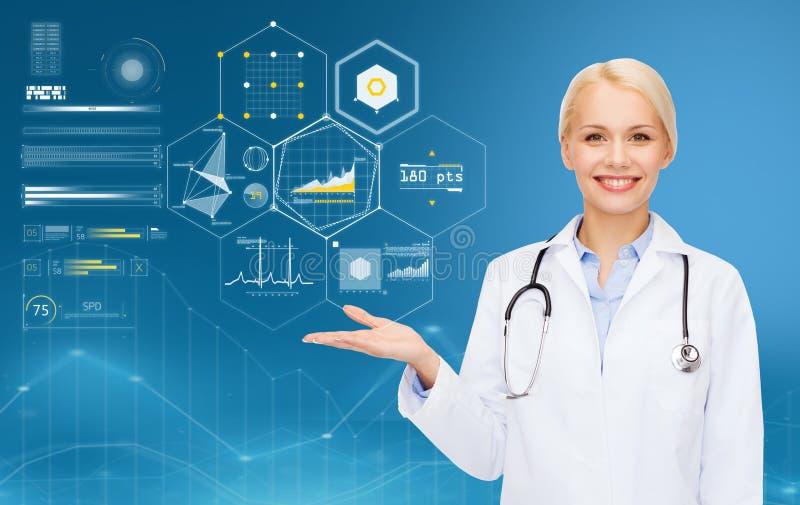 Gelukkige arts met stethoscoop en grafieken over blauw royalty-vrije stock afbeelding