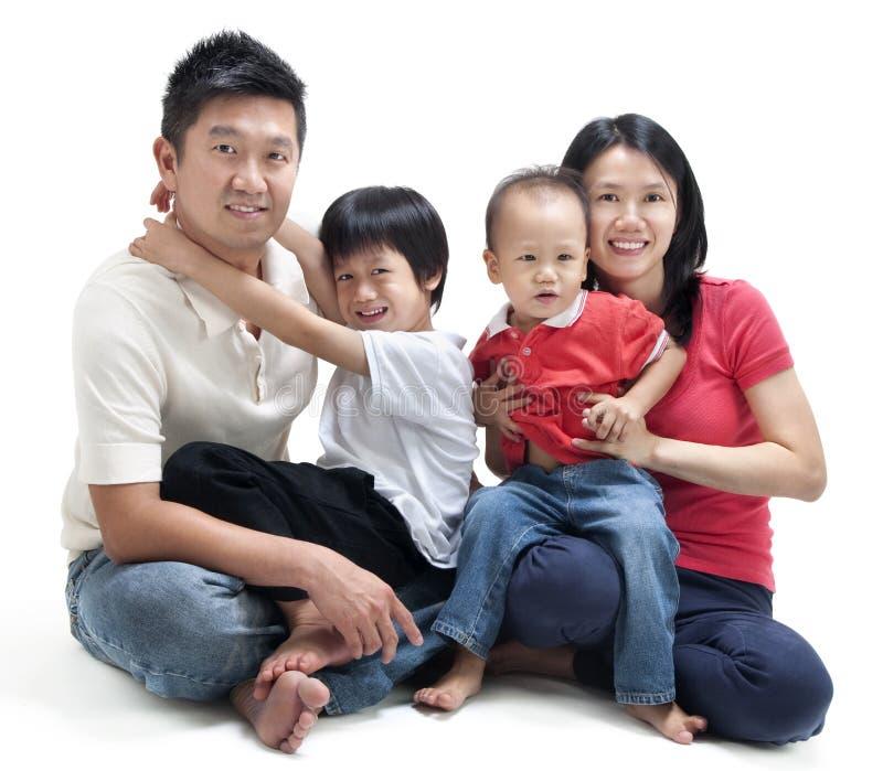 Gelukkige Aziatische familie stock foto's