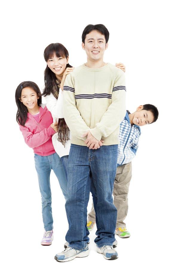 Gelukkige Aziatische familie die op wit wordt geïsoleerdt royalty-vrije stock foto