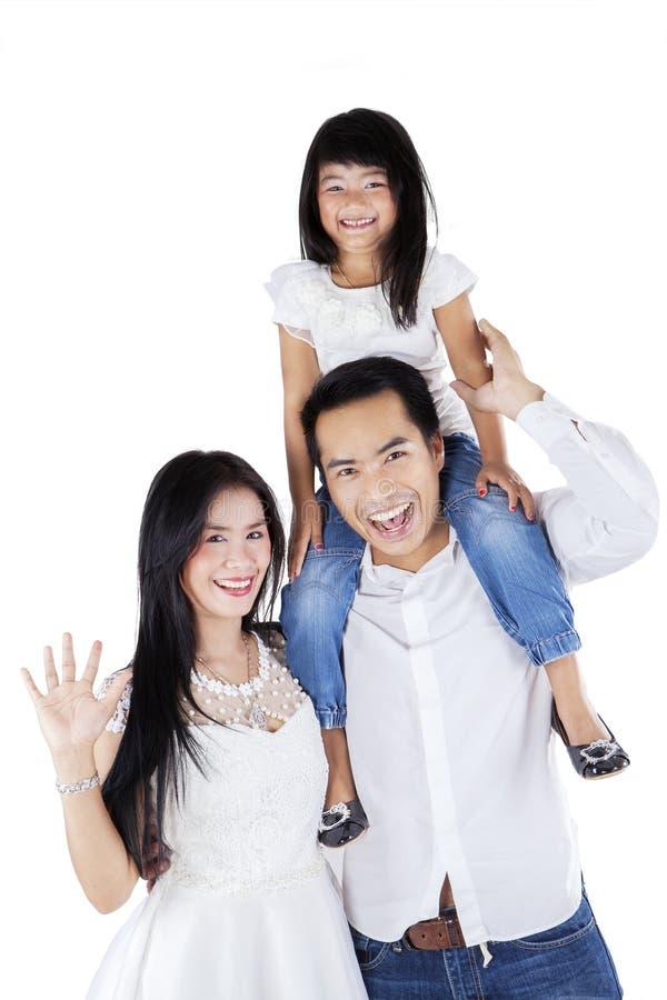 Gelukkige Aziatische familie op witte achtergrond royalty-vrije stock afbeeldingen