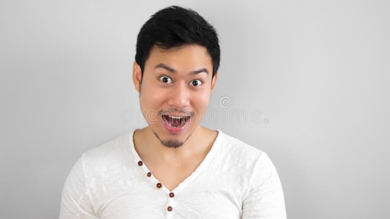 Gelukkige Aziatische mens stock foto's