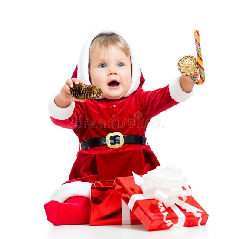 Gelukkige baby in Santa Claus-kleren royalty-vrije stock foto's