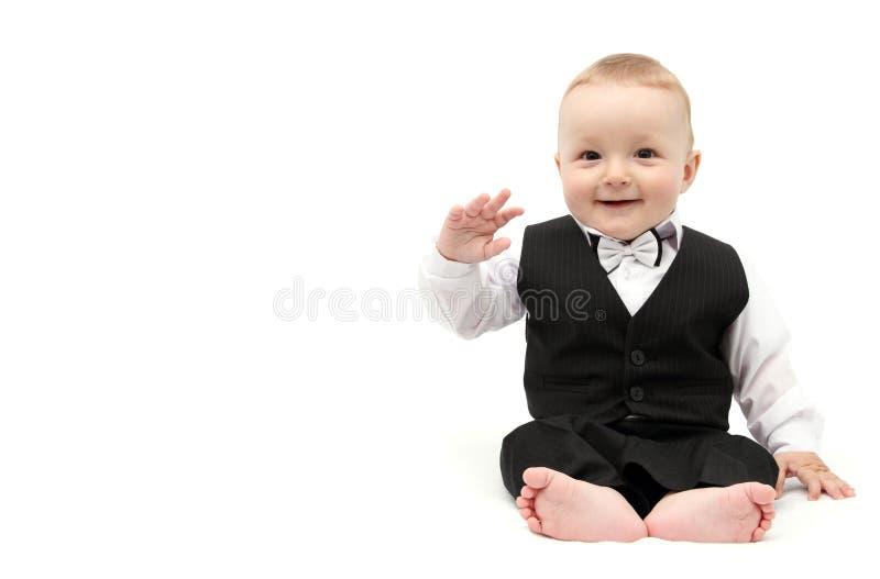 Gelukkige babyjongen in kostuum royalty-vrije stock fotografie
