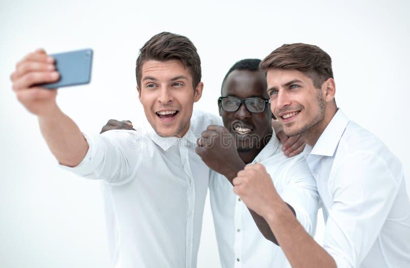 Gelukkige bedrijfscollega's die selfies nemen stock foto's
