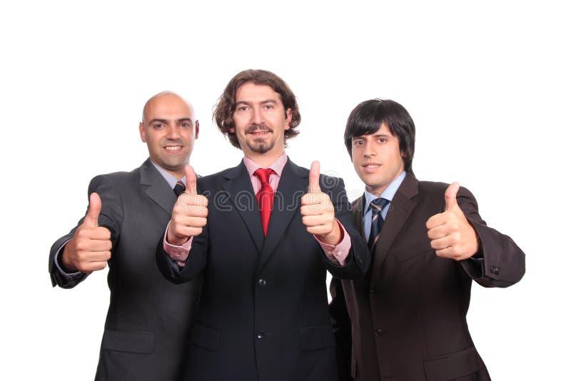 Gelukkige bedrijfsmensen met omhoog duimen royalty-vrije stock afbeeldingen
