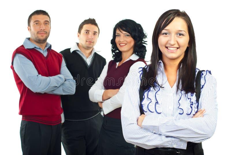 Gelukkige bedrijfsvrouw en haar team stock foto