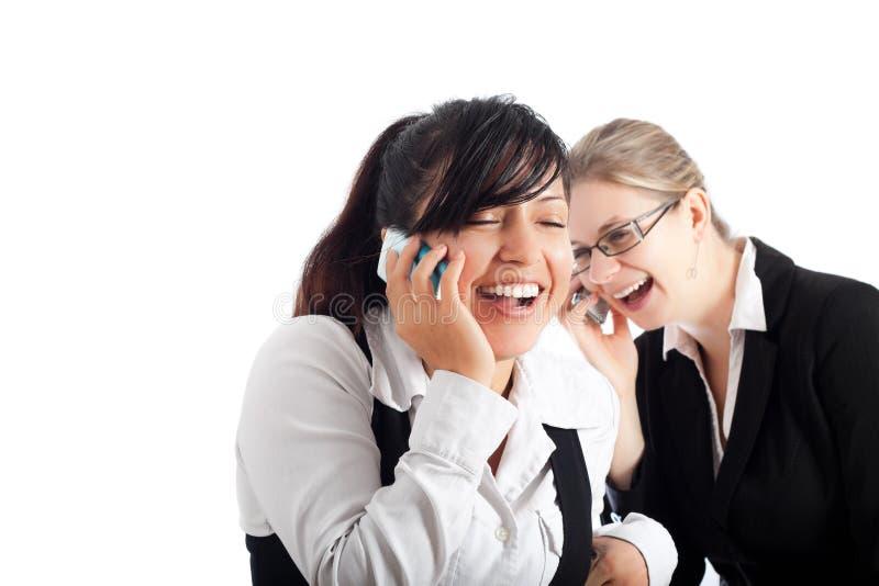 Gelukkige bedrijfsvrouwen op de telefoon royalty-vrije stock afbeelding