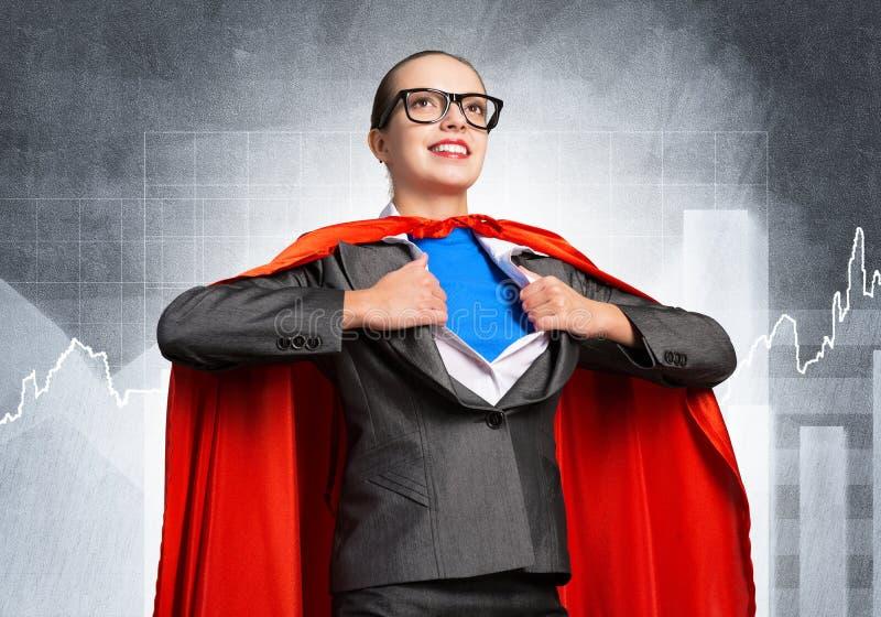 Gelukkige bedrijfsvrouwen super heldin stock foto