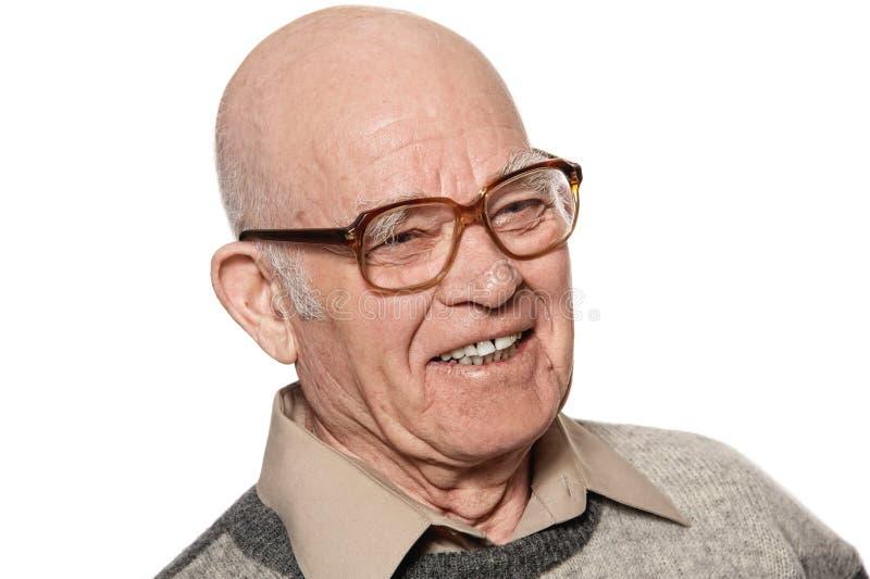Gelukkige bejaarde die op witte achtergrond wordt geïsoleerdo. royalty-vrije stock afbeelding