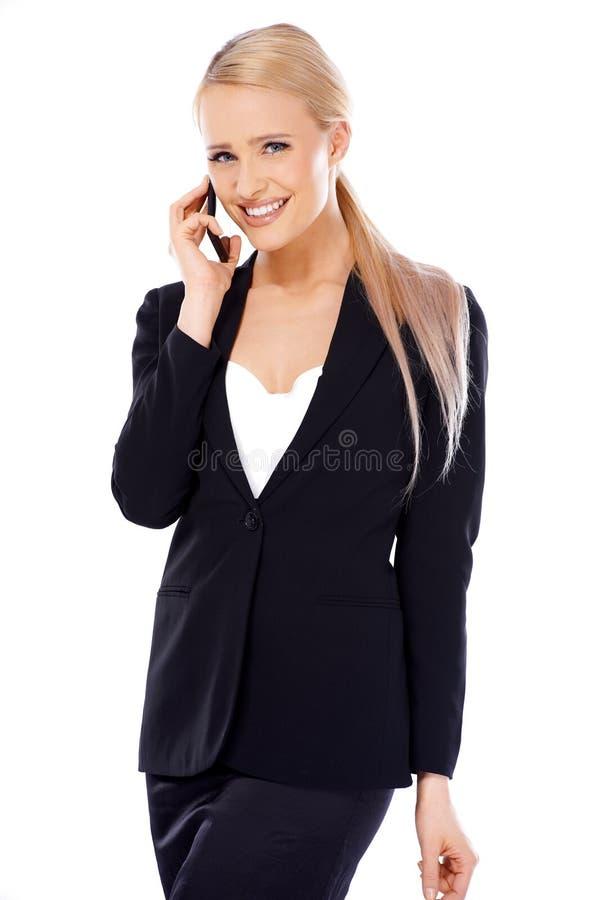 Gelukkige blonde bedrijfsvrouw die mobiel haar gebruiken royalty-vrije stock foto's
