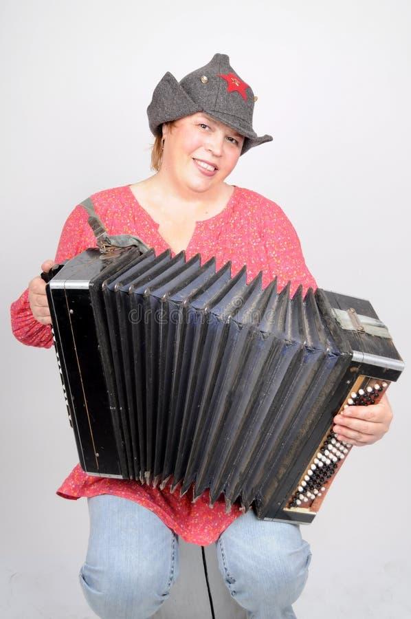 Vrouw met harmonika stock fotografie