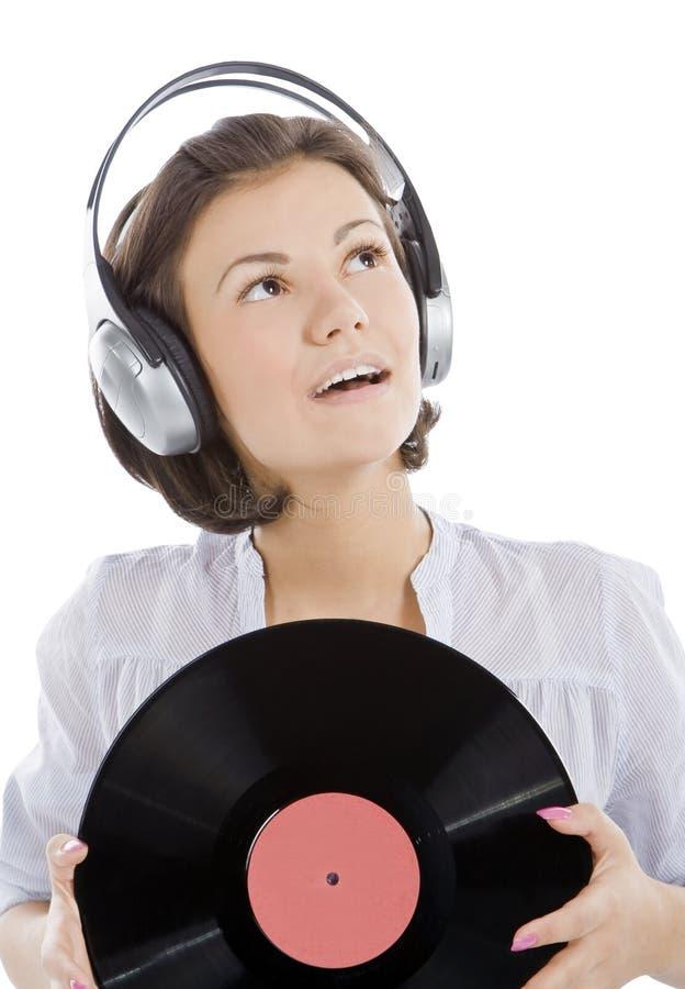 Gelukkige brunette in hoofdtelefoons met vinylverslag royalty-vrije stock fotografie