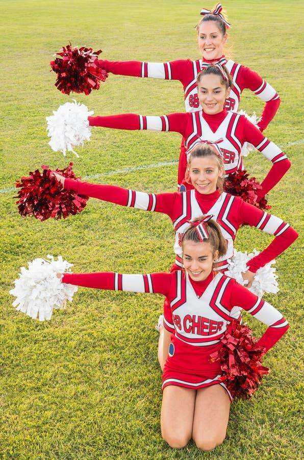 Gelukkige Cheerleaders tijdens Tentoonstelling stock fotografie