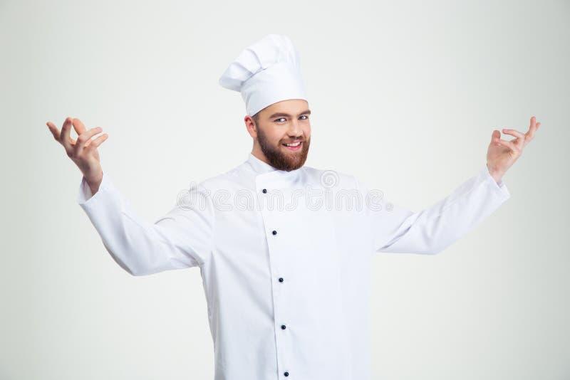 Gelukkige chef-kokkok die welkom gebaar tonen royalty-vrije stock fotografie