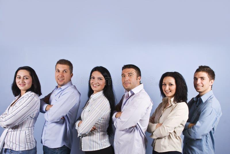 Gelukkige commerciële groep met glimlachende mensen royalty-vrije stock afbeelding