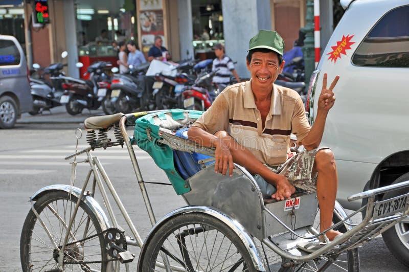 Gelukkige Cyclobestuurder in Ben Tanh Market. royalty-vrije stock afbeelding