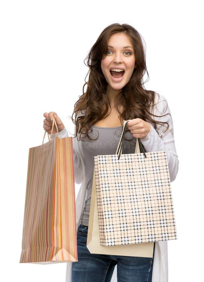 Gelukkige dame met het winkelen zakken royalty-vrije stock afbeelding