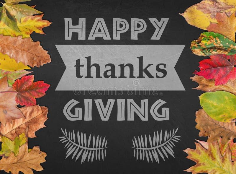 Gelukkige Dank die dag als prentbriefkaarseizoen het van letters voorzien met de herfstbladeren geven stock fotografie