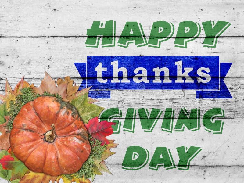 Gelukkige dank die dag en pompoen met de herfstbladeren geven op wit stock afbeelding