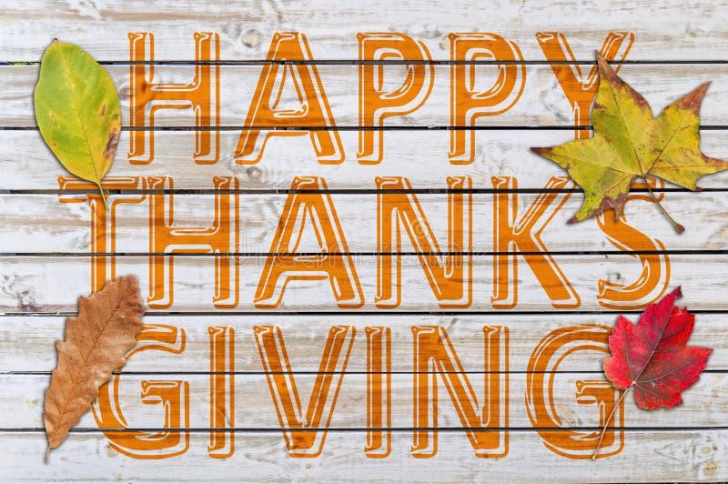 Gelukkige Dank die met de vier die herfstblad geven op wit hout wordt geschreven stock foto