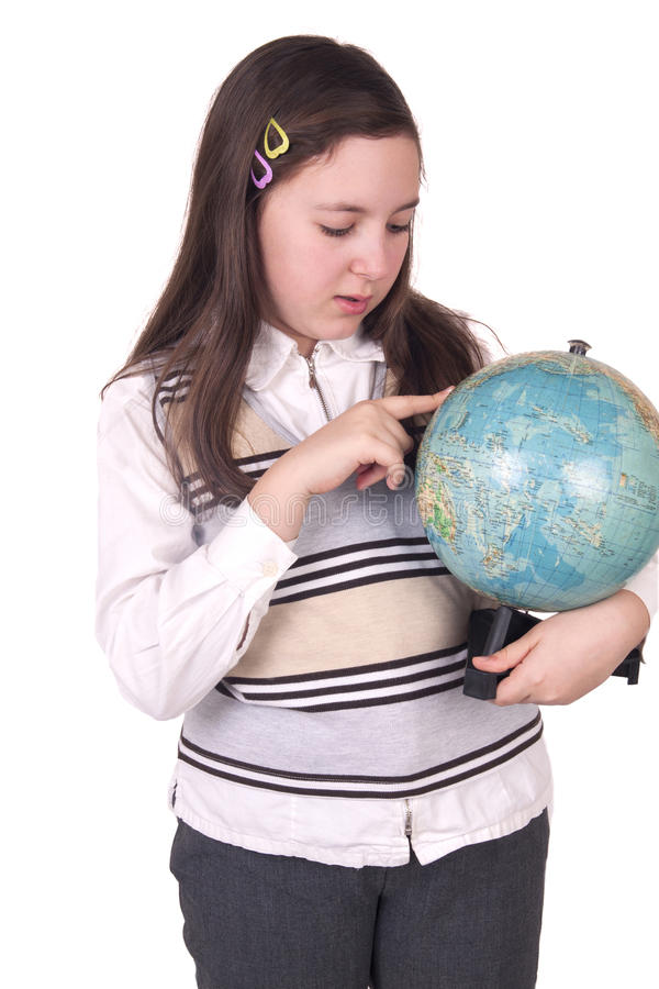 Gelukkige de holdingsbol van het schoolmeisje stock foto