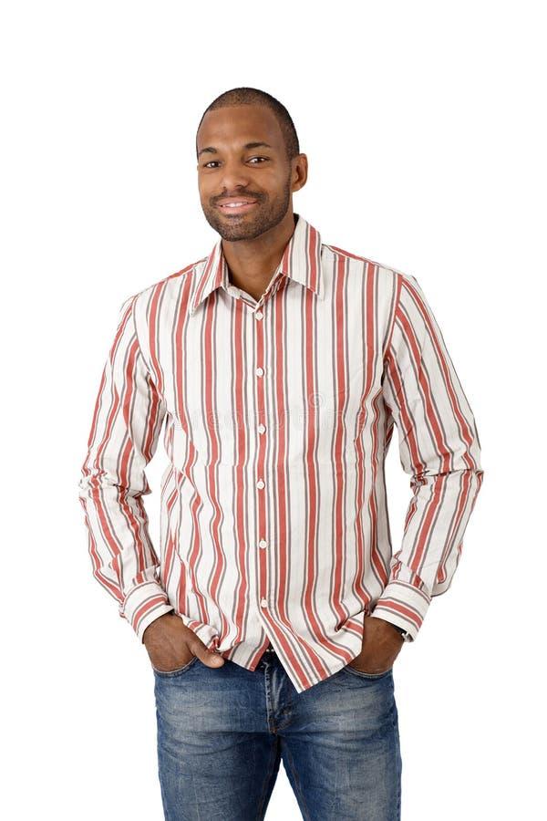 Gelukkige etnische kerel in gestreept overhemd royalty-vrije stock afbeeldingen