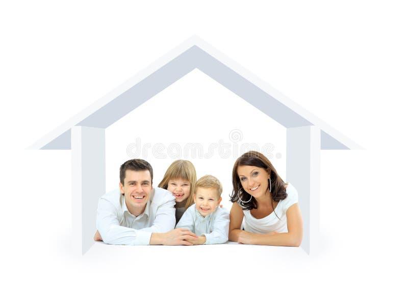 Gelukkige familie in een huis stock foto's