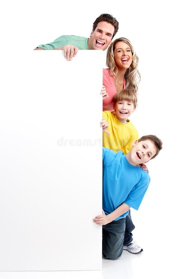 Gelukkige familie met banner. stock afbeelding
