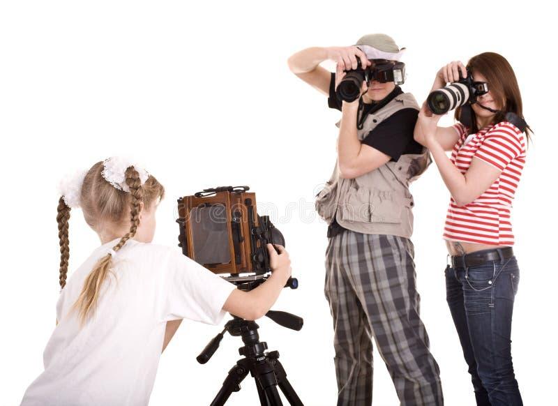 Gelukkige familie met camera drie. royalty-vrije stock afbeelding
